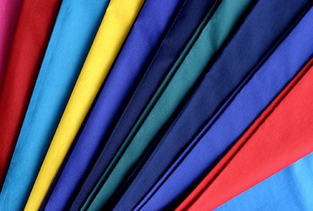vải may áo khoác gió đồng phục